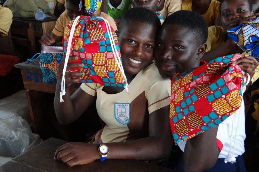 Girls holding kits in Ghana