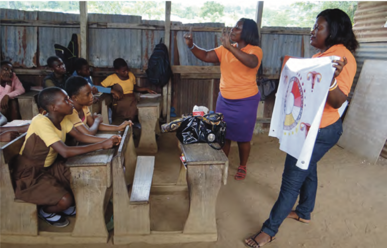 An important part of the Be in School Every Day program is training for both girls and boys on menstrual hygiene. Above, educators use board games, posters, and interactive activities to reinforce key messages about menstrual health (June 2018). Photo by Mary Crave