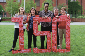 """4W leaders and Chancellor Blank celebrate 150 years of women at UW with """"150th Annivers-berry"""" ice cream (June 2019)."""