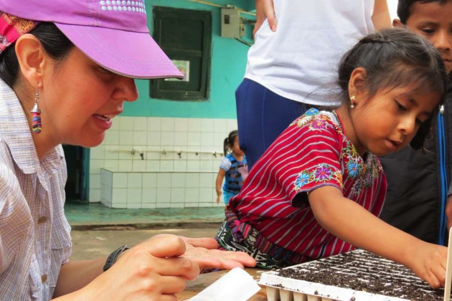 FIG Leader with a child in Latin America