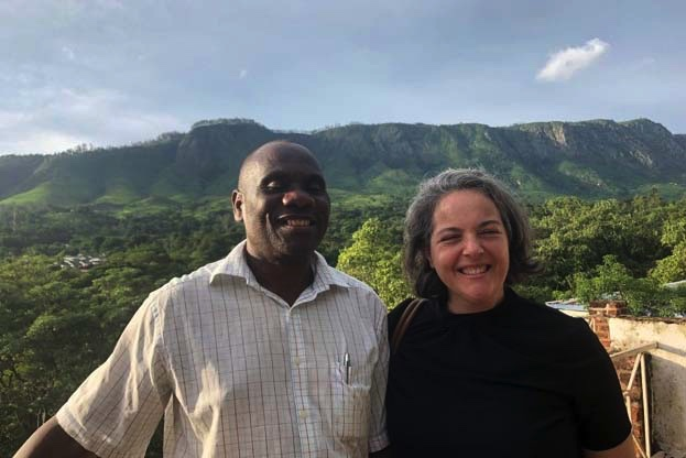 Malawi Project Leaders smiling in front of foliage